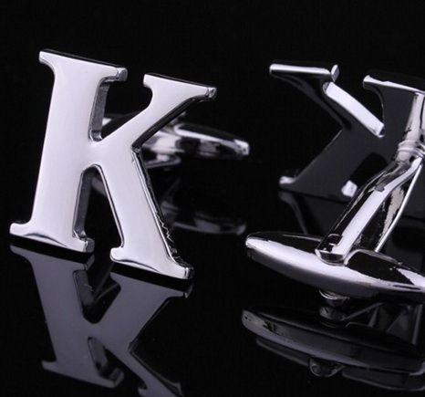 Запонки буква K